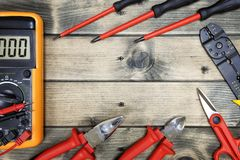 Top view of work tools for residential electrical installation on antique wooden background. Close up of work tools for residential electrical installation on royalty free stock photos