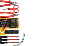 Top view of work tools for residential electrical installation on white background. royalty free stock image