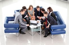 Working business group sitting at table during corporate meeting. Top view of working business group sitting at table during corporate meeting Stock Images