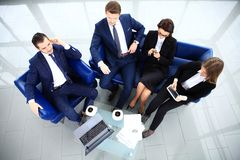 Top view of working business group sitting at table. During corporate meeting Royalty Free Stock Photos