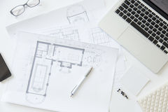 Top view of a working desk with an architect drawing Stock Photography