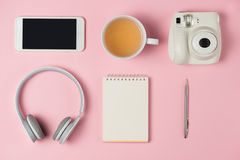 Top view of working desk with blank notebook with pen, tea cup, stock photo