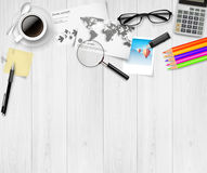 Top view of working place elements on white table Stock Photos