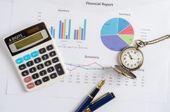 Top view of working table with financial report, pocket watch, c Royalty Free Stock Photos