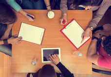 Top view of working table with students in teamwork Stock Images