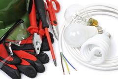 Top view of working tools and components of the electrical system on white background. Safety equipment, work tools and components for a residential electrical stock photo