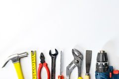 Top view of Working tools,wrench,socket wrench,hammer,screwdrive. R,plier,electric drill,tape measure,machinist square on white background. flat lay design Royalty Free Stock Image