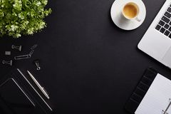 Top view of workplace, coffee cup with laptop, diary and phone royalty free stock photo