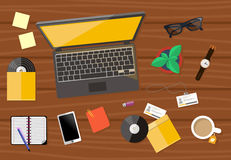 Top view of workplace with laptop and devices Royalty Free Stock Image