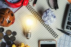 top view workplace and lightbulb on book with office supplies ar royalty free stock photo