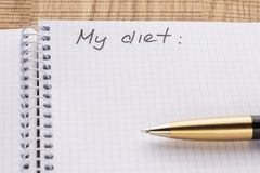 Top view workplace notebook and pen on wood table background, retro effect. Inscription - My diet stock photo