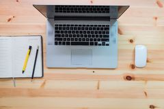 Top view of workspace and computer laptop on table desk.  Royalty Free Stock Photography