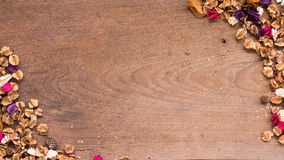 Top view workspace with dried flowers on wooden table background. Free space for your text Stock Images