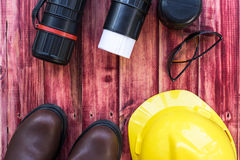 Top view of the workspace of an engineer. With a safety helmet and safety boot Royalty Free Stock Photo