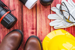 Top view of the workspace of an engineer. With a safety helmet and safety boot Stock Photography