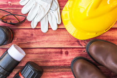 Top view of the workspace of an engineer. With a safety helmet and safety boot Royalty Free Stock Photography