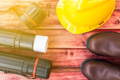 Top view of the workspace of an engineer. With a safety helmet and safety boot Royalty Free Stock Images