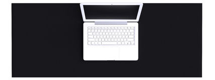 Top view of workspace with laptop on table. Stock Image