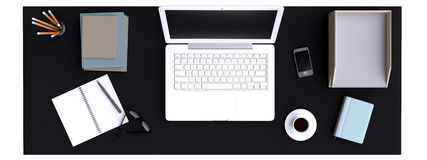 Top view of workspace with laptop on table. Stock Photo