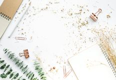 Top view of worktable with mock up accessories. And dry flower.flat lay design/copy space Royalty Free Stock Photo