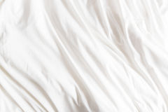 Top view of wrinkles on an unmade bed sheet. Royalty Free Stock Photo