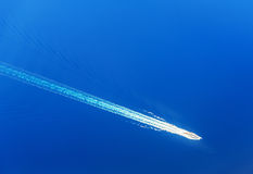 Top view on yacht in the blue sea royalty free stock photo