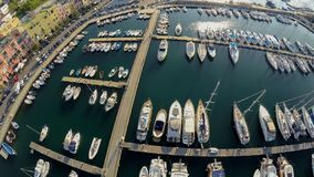 Top view of yachts and boats moored at beautiful Italian city, summer vacation. Stock photo stock images