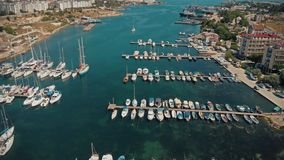 Seascape with boats. Top view of yachts from flying drone stock footage