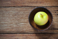 Top view yellow apple in wood bowl Stock Images