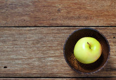 Top view yellow apple in wood bowl Royalty Free Stock Image