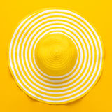 Top view of yellow hat. Top view of yellow striped retro hat close-up. summer concept Royalty Free Stock Photo