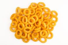 Top view of yellow round potato snacks pile isolated on white Stock Photo