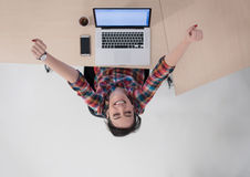 Top view of young business woman working on laptop Stock Photo