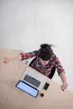 Top view of young business woman working on laptop Stock Photography