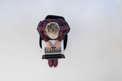 Top view of young business woman working on laptop computer Royalty Free Stock Photos