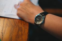 Top view. businessman wearing wrist watch on his arm. while stay. Top view. young businessman wearing wrist watch on his arm. while staying in meeting room have Stock Images