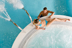 Top view - young couple relax in swimming pool. Sitting at bubble bath Royalty Free Stock Images