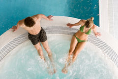 Top view - young couple relax in swimming pool. Sitting at bubble bath Stock Photos