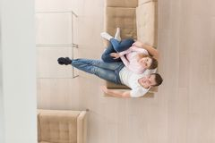 Young couple on the sofa watching television top view Royalty Free Stock Photography