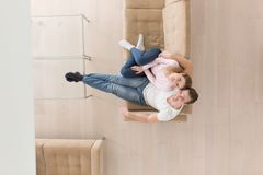 Young couple on the sofa watching television top view Stock Photo