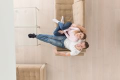 Young couple on the sofa watching television top view Stock Photos