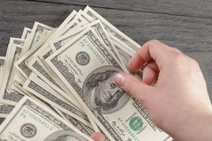 Top view of young female hands count dollar bills Royalty Free Stock Photo