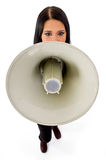 Top view of young female holding loudspeaker Royalty Free Stock Photos