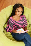 Top view young girl writing in diary Stock Photo