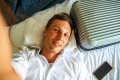 Top view. Young businessman relaxing on bed after a tough day at work. royalty free stock photos