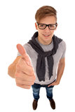 Top view of a young man going thumb up. Stock Photography