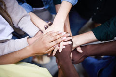 Top view of young people putting their hands together. royalty free stock photography