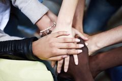 Top view of young people putting their hands together. royalty free stock image