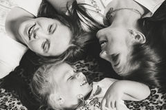 Top view of young sisters girls laughing happily royalty free stock photography