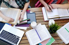 Top view of young students with books and notes in cafe Royalty Free Stock Photography